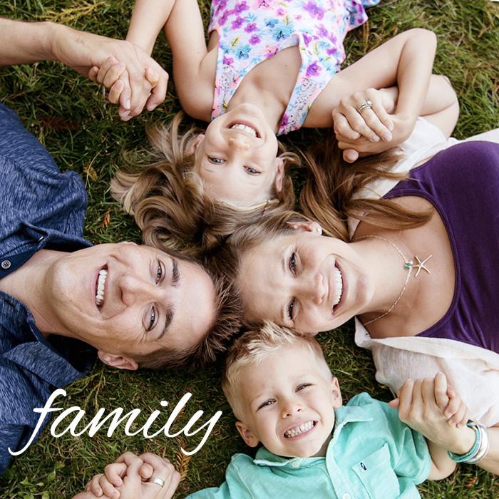 Family-4-lay-down-grass-happy.jpg