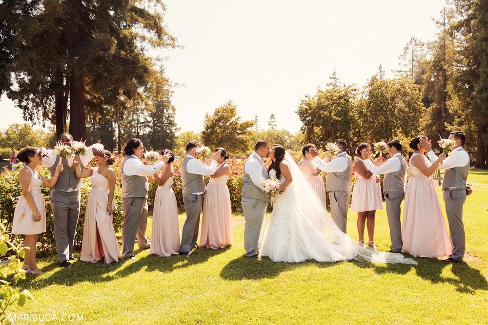 39__39-sj-rose-garden-wedding-party-photography-kiss.jpg