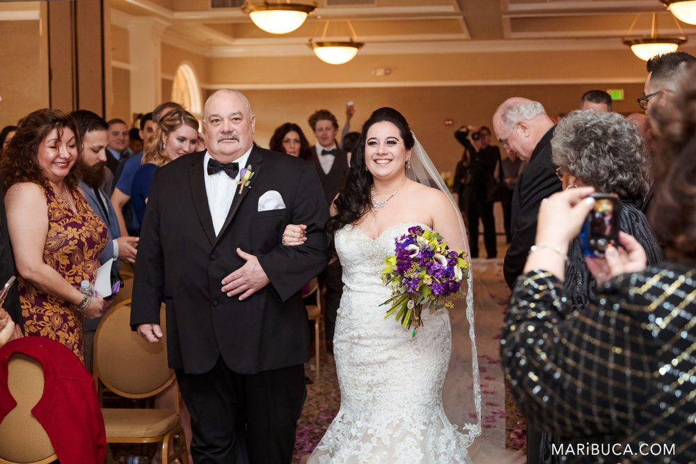 Dad walks happy daughter down aisle on wedding day in the Villa Ragusa