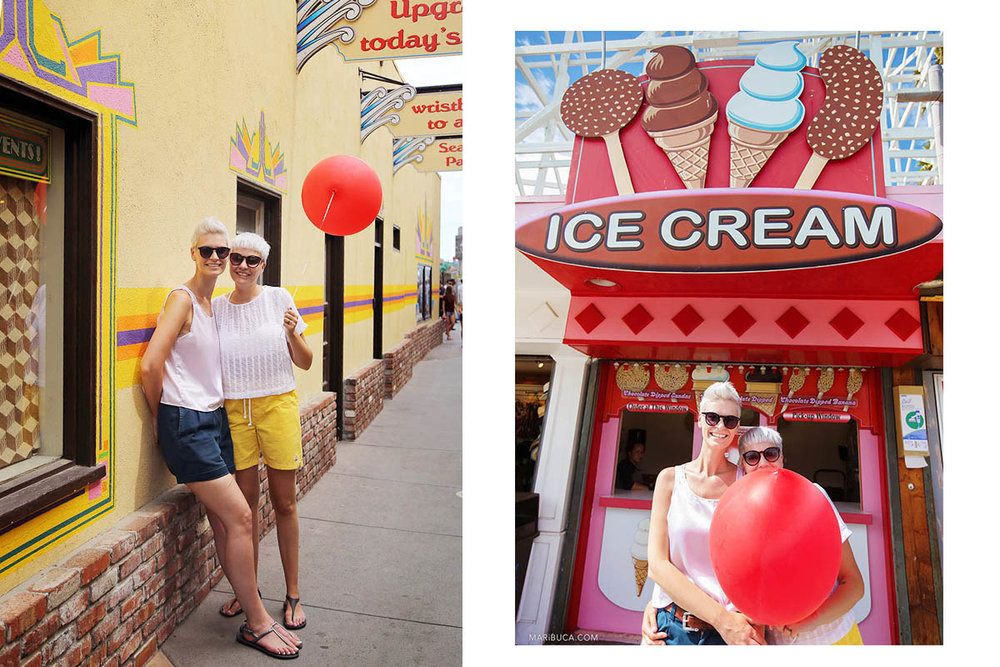 beautiful girls in sunglasses, white T-shirts, colored shorts and holding a flying red ball against the yellow wall and a red ice cream store.