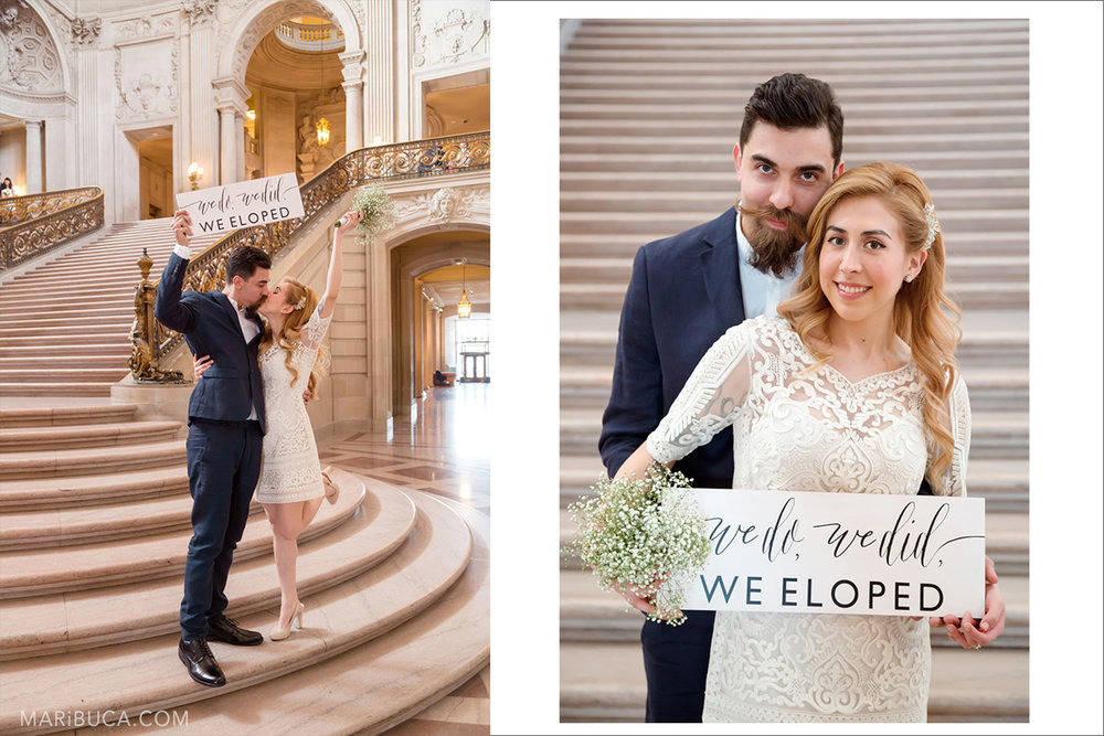 "Bride and groom kiss each other and show the sign: ""we do, we did, we eloped!"" in the staircases in the San Francisco City Hall."
