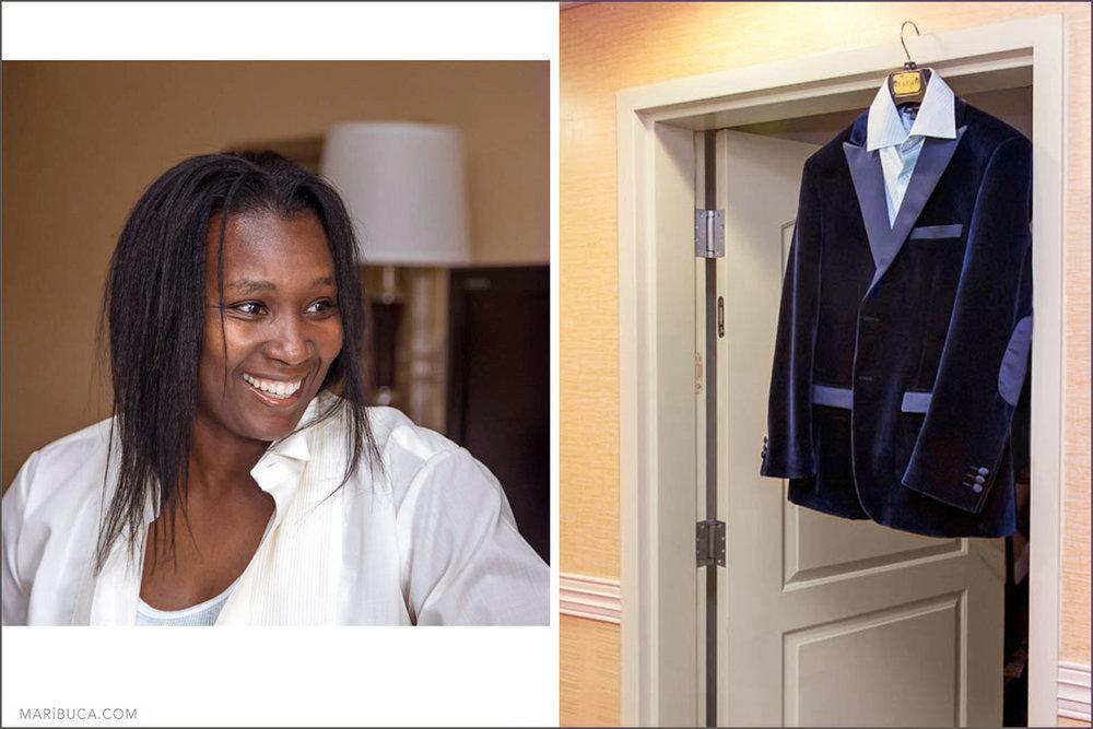 Portrait of the groom during the getting ready. Same sex couple. Dark blue velvet wedding jacket hangs on under door.