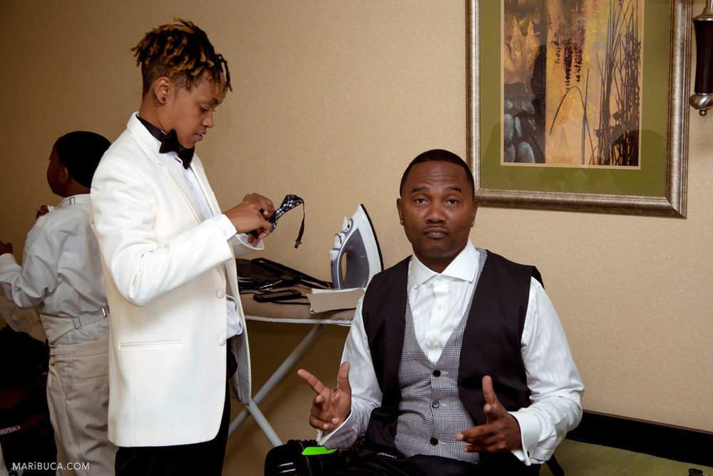 Groomsmen are getting ready in the hotel, Brentwood