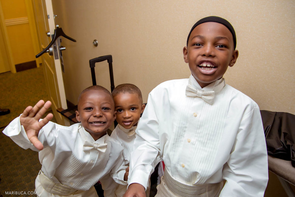 Happy kids in the wedding during getting ready in the groomsmen room