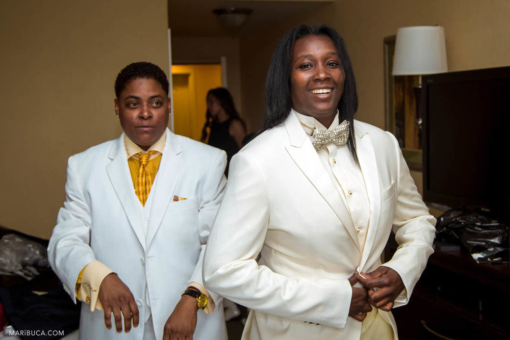 The groom is wearing the white jacket as well as the groomsmen as the same sex wedding during getting ready in the hotel
