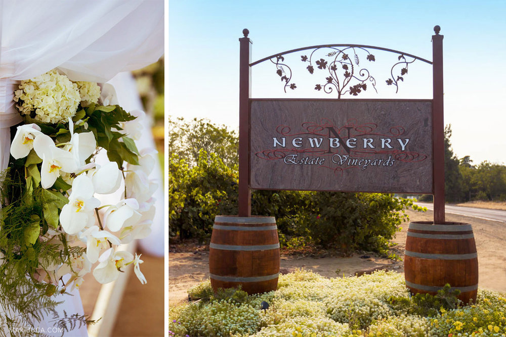 Wedding decoration: white flowers, Newberry Estate Vineyards sign with leaves decoration on it.