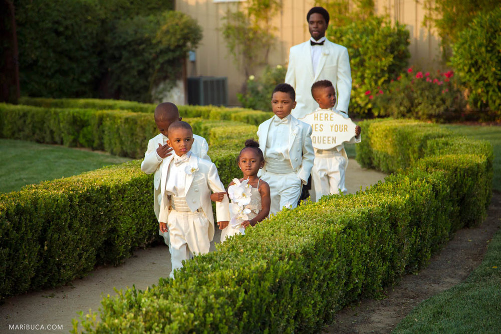 Flower girls and Barrier Rings go to the outdoor in the Newberry Estate Vineyards ceremony.