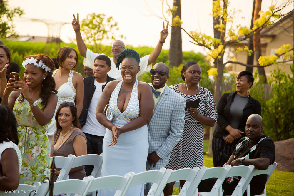 Happy guests so excited are waiting the ceremony and the groom and the bride