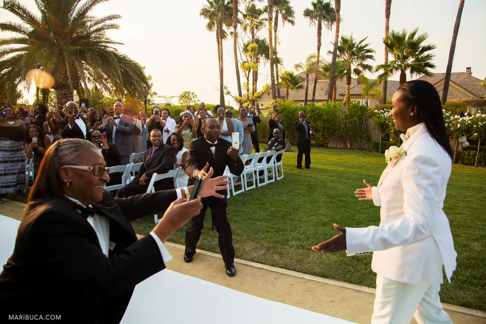 Guests take pictures of the groom before the ceremony in the Newberry Estate Vineyards