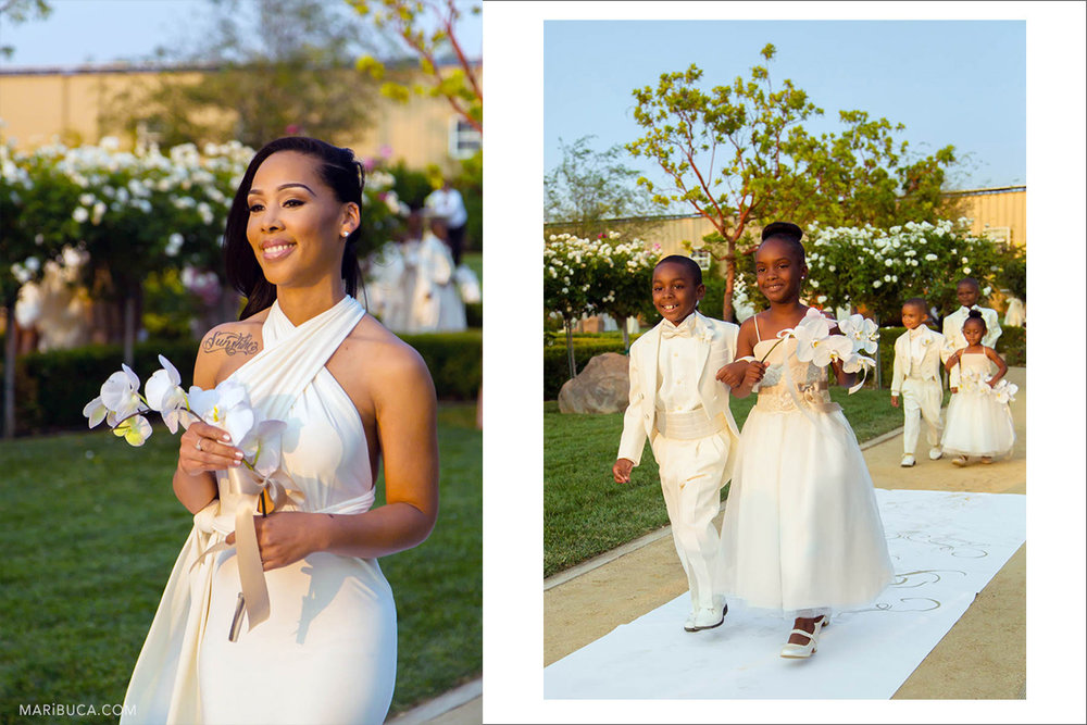 Bridesmaid, flower girl and Barrier Rings in the white dresses go down the aisle in the Newberry Estate Vineyards