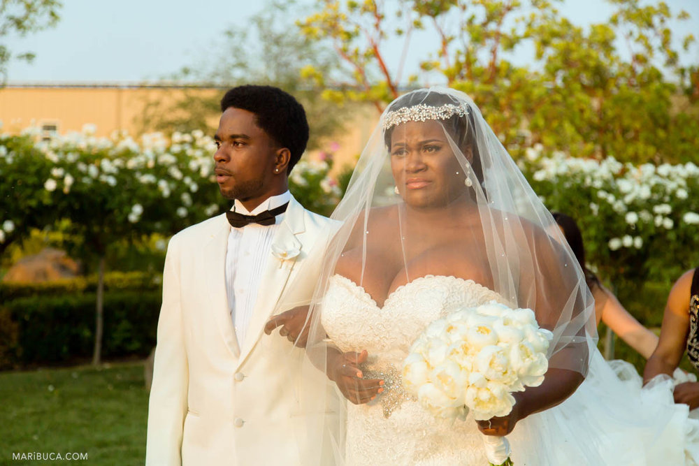 Bride and her brother are walking down the aisle in the Newberry Estate Vineyards.