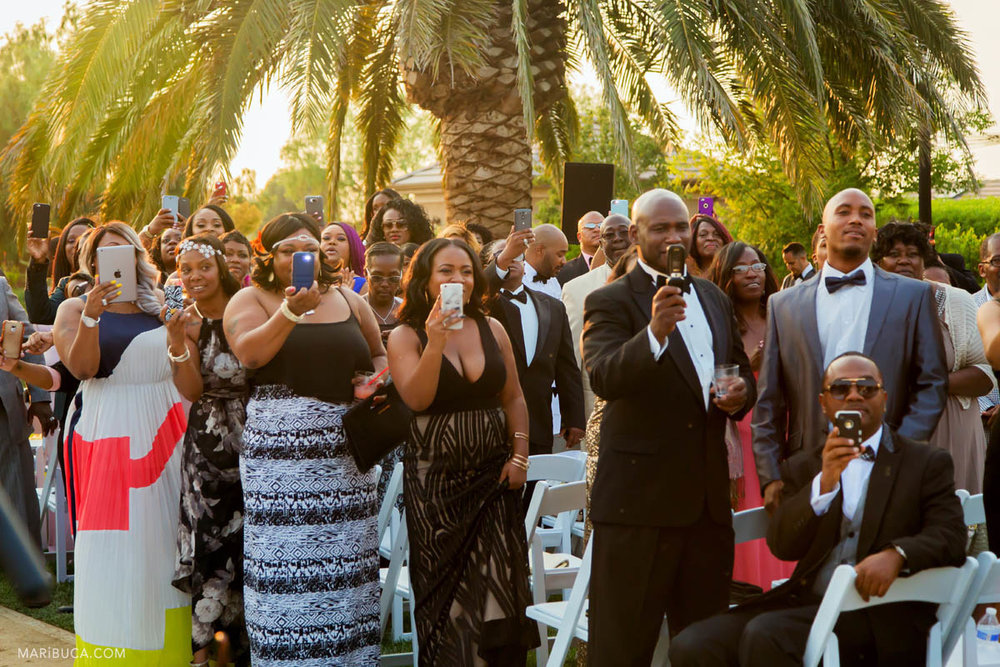 All guests stay with smartphones for take pictures and video to the bride.
