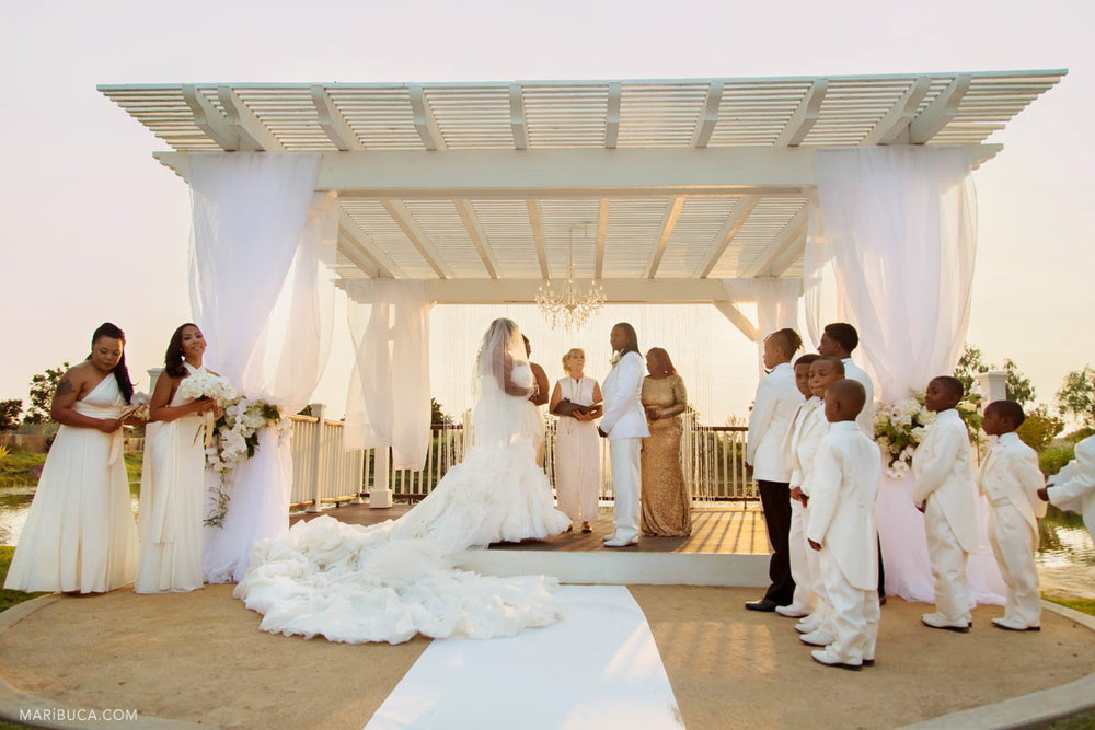 Ceremony started and everybody dressed with white color dresses and suits including the decorations around.