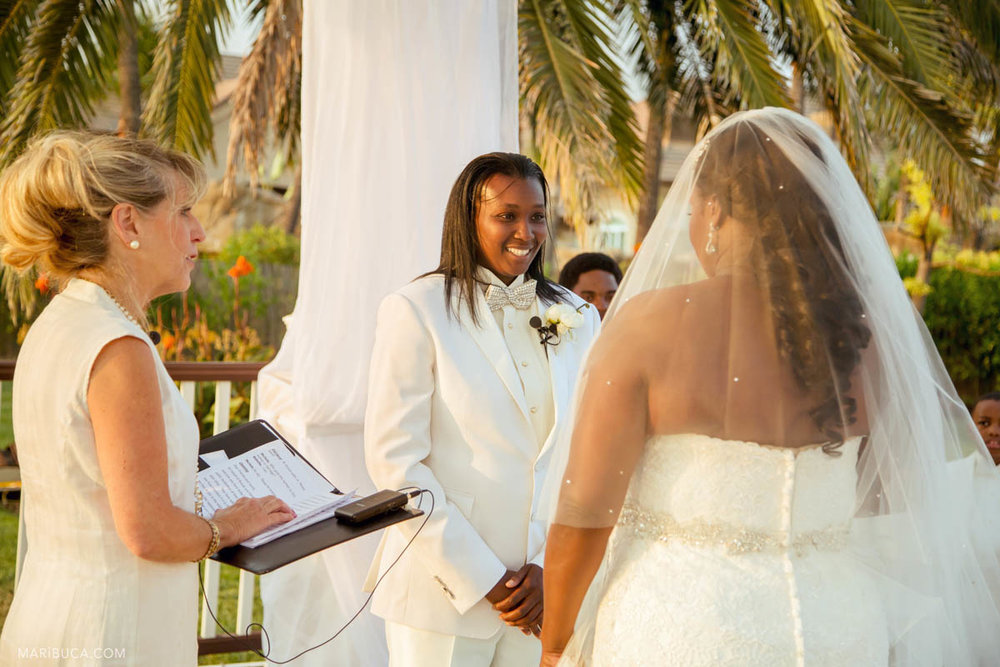 The happy groom looks in her the adorable bride their white wedding ceremony..
