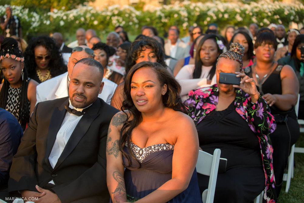 People pay attention in the wedding ceremony in the orange rays of sunset