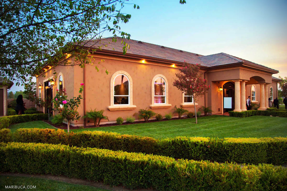 Brentwood venue and Newberry Estate Vineyards building after sunset.