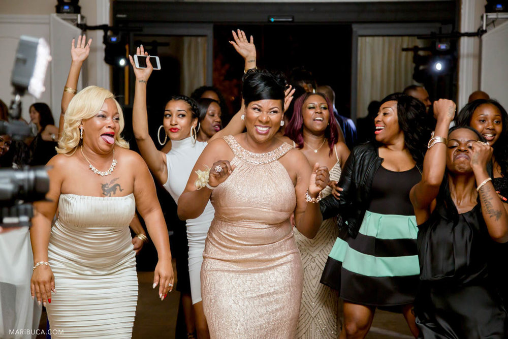 People dancing and having fun in the Newberry Estate wedding
