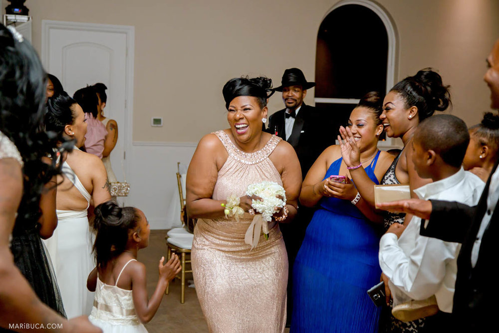 Guests have fun in the wedding, Brentwood, CA and the one of the bridesmaids caught bouquet in the wedding.