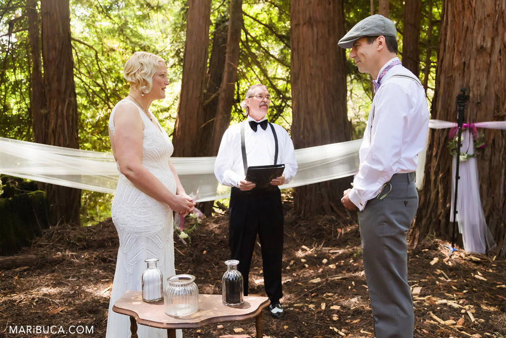 Groom and bride look each other in the ceremony in the Saratoga Springs,, California