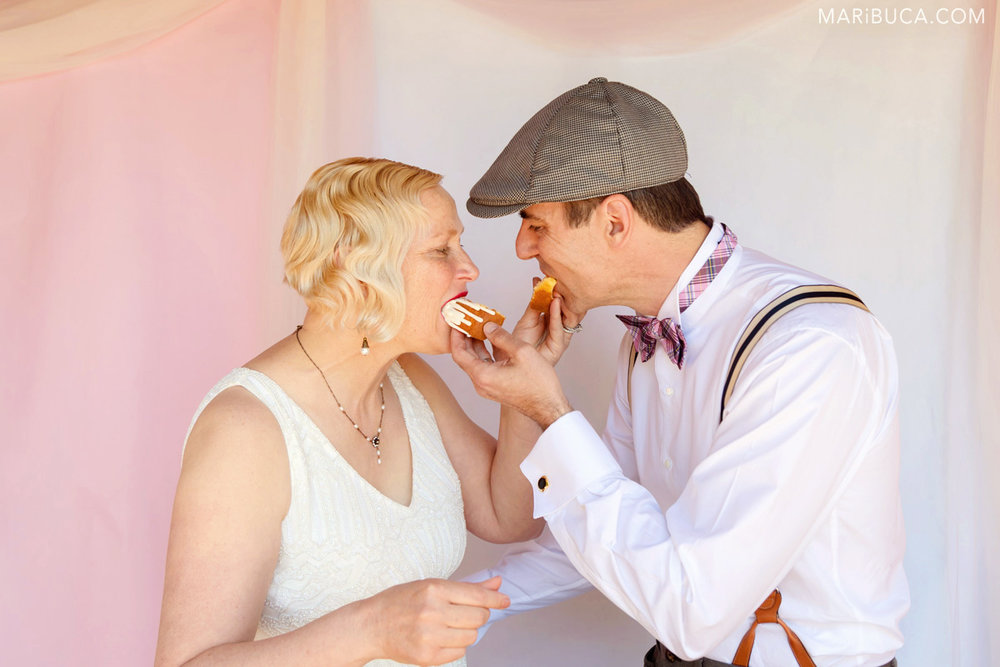 Bride and groom feed each other after cutting their first wedding cake