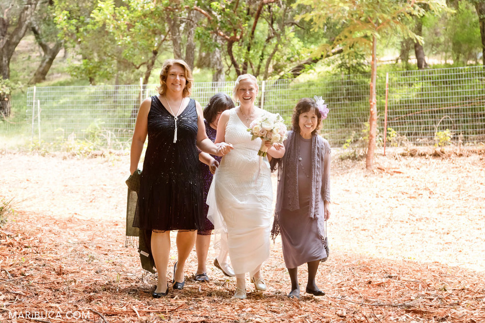 The bride with bridesmaids go down the aisle in the Los Gatos wedding. .