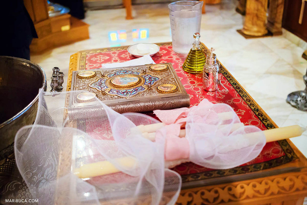 Details for christian baptism in church: bible and candles in San Jose Greek Orthodox church