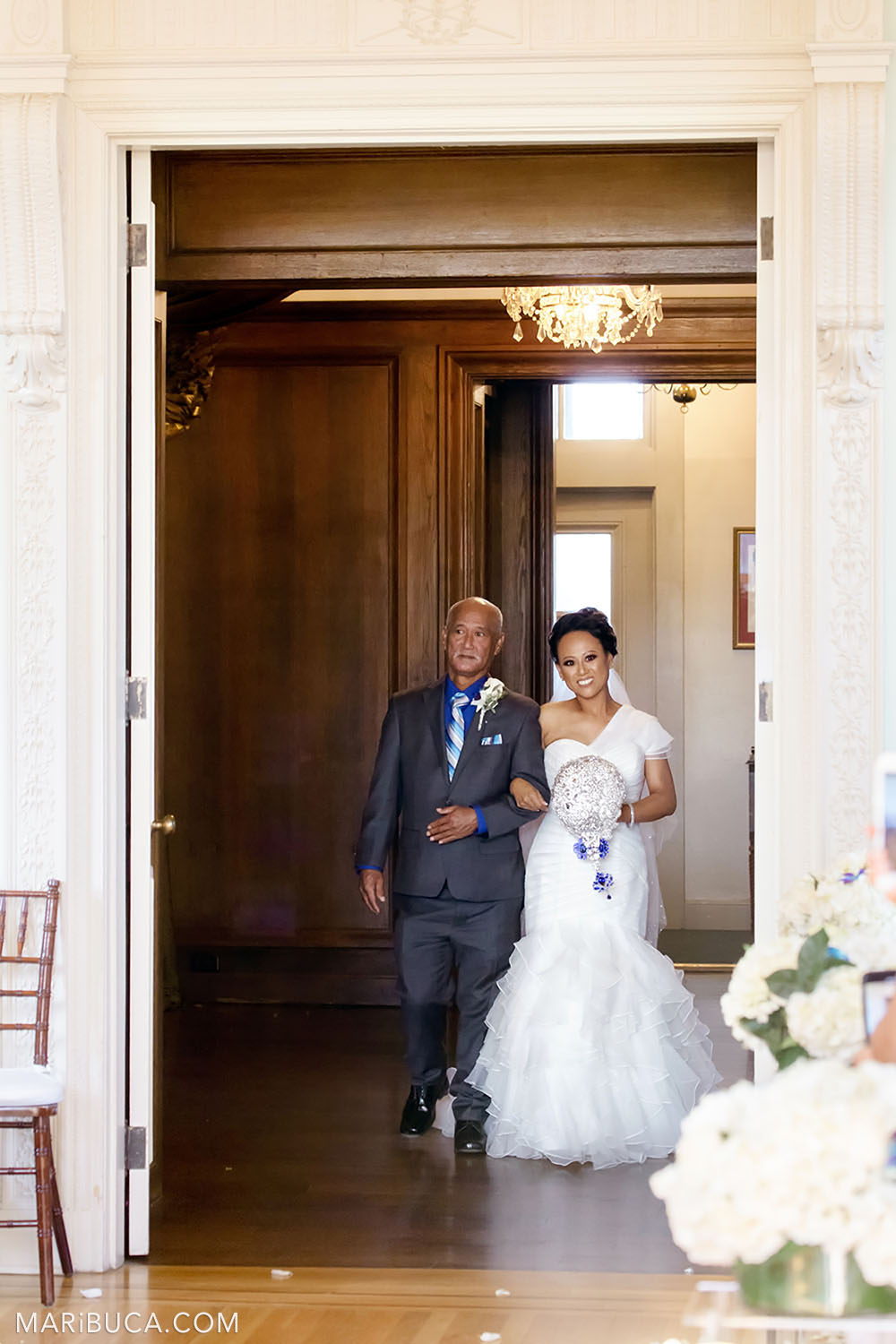 Bride and her dad are going down the aisle in the Dining room, Kohl Mansion Wedding ceremony
