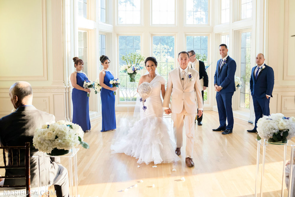 The bride and the groom are leaving the wedding ceremony in the Dining room, Kohl Mansion Wedding, Burlingame.