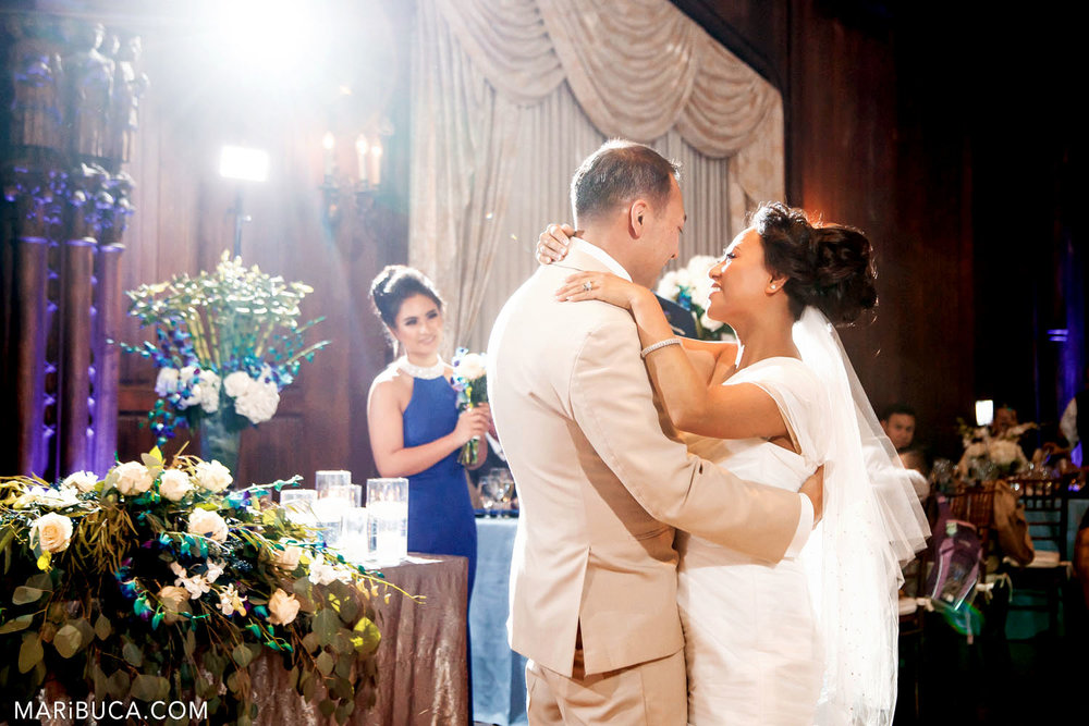 the first dance of the bride and groom and white light in the background in the Great Hall, Kohl Mansion, Burlingame