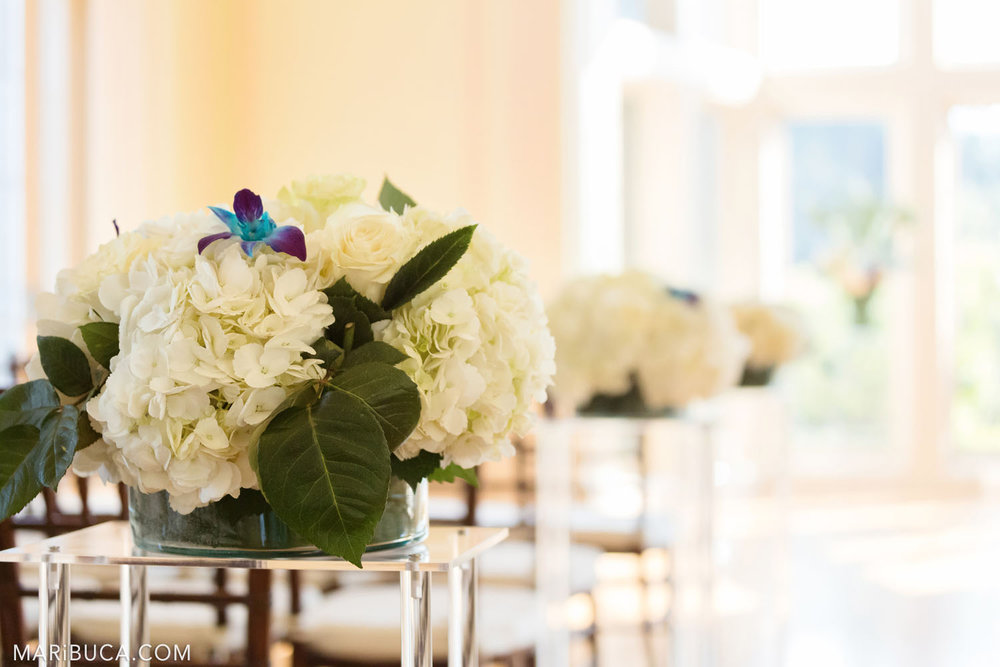 the wedding ceremony is decorated with white and blue flowers in the Dining room, Kohl Mansion, Burlingame