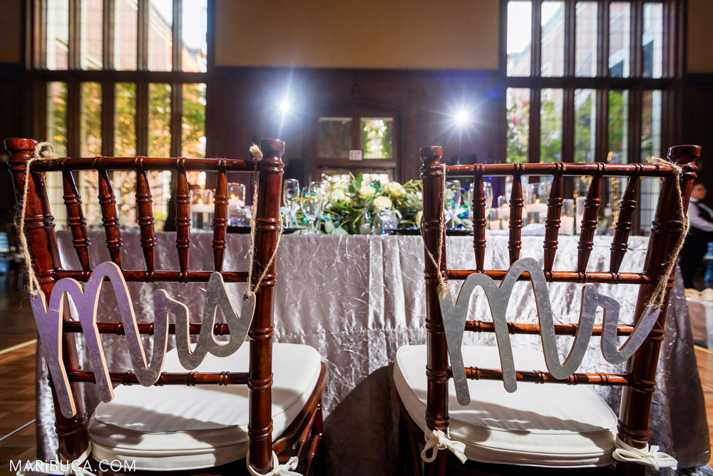 on the chairs of the newlyweds hang Mr and Mrs against the background of large windows and a brown background in the Great Hall, Kohl Mansion, Burlingame.
