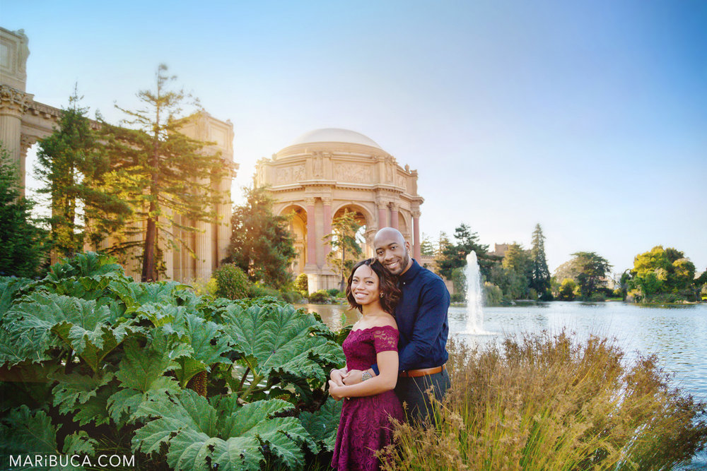 San Francisco Engagement Palace of Fine Art with beautiful fiance and fiancee stand in front of it.