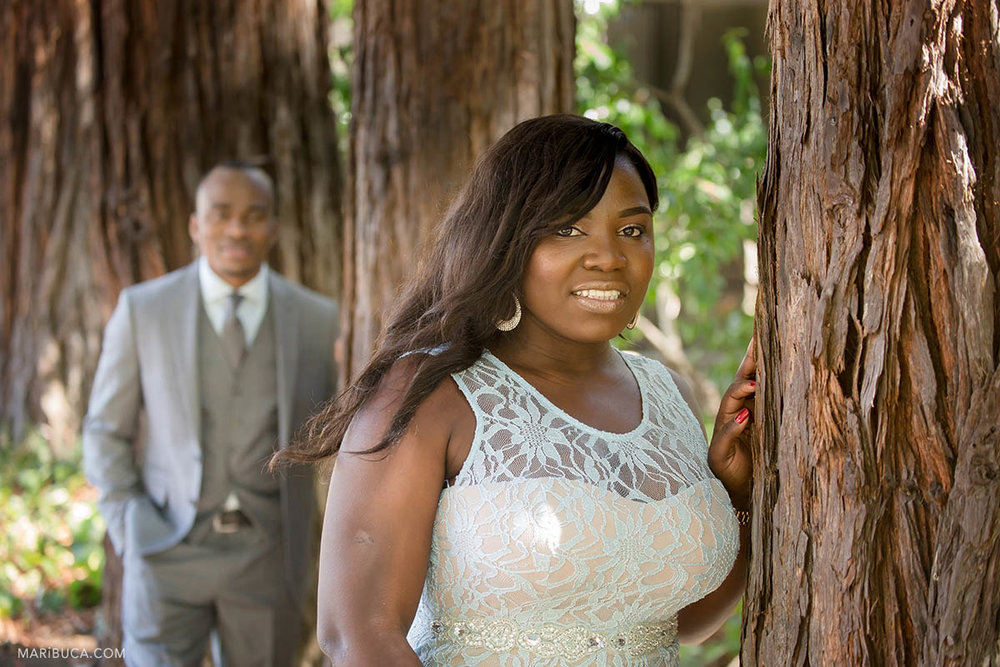 The bride and groom have photo-session in the Hayward Japanese garden surrounded the big old trees.