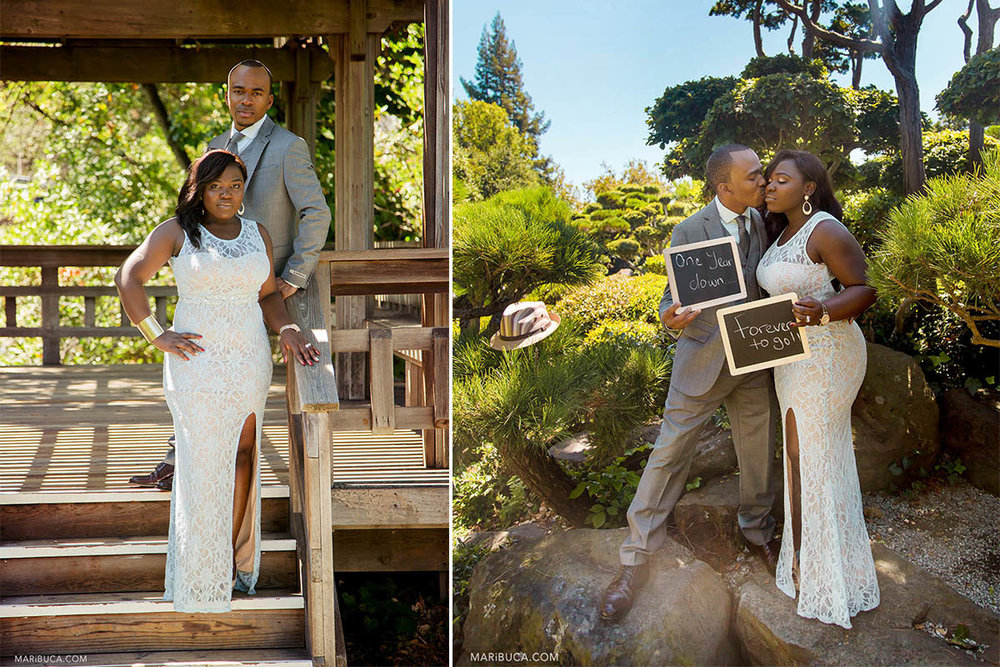 """Bride and groom hold 2 chalk board with signs """"forever to go"""" and """"one year down in the Hayward Japanese Garden during the summer time."""