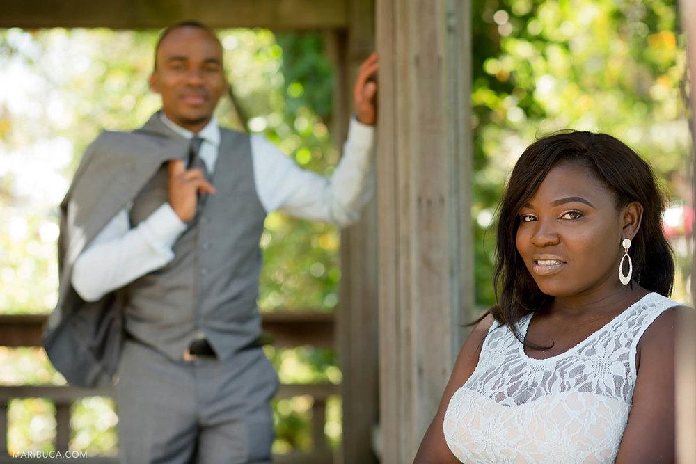 The bride stands in front of her handsome groom in the Hayward Japanese Garden.