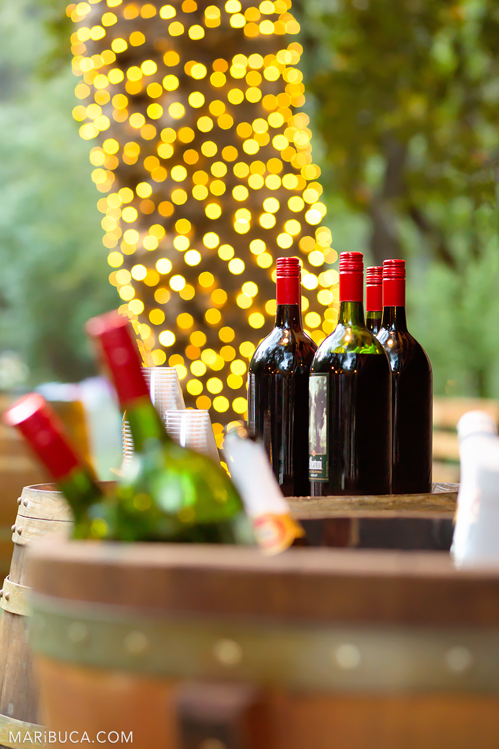 Bottle of wines surrounded yellow and orange lights in the Saratoga Springs Venue
