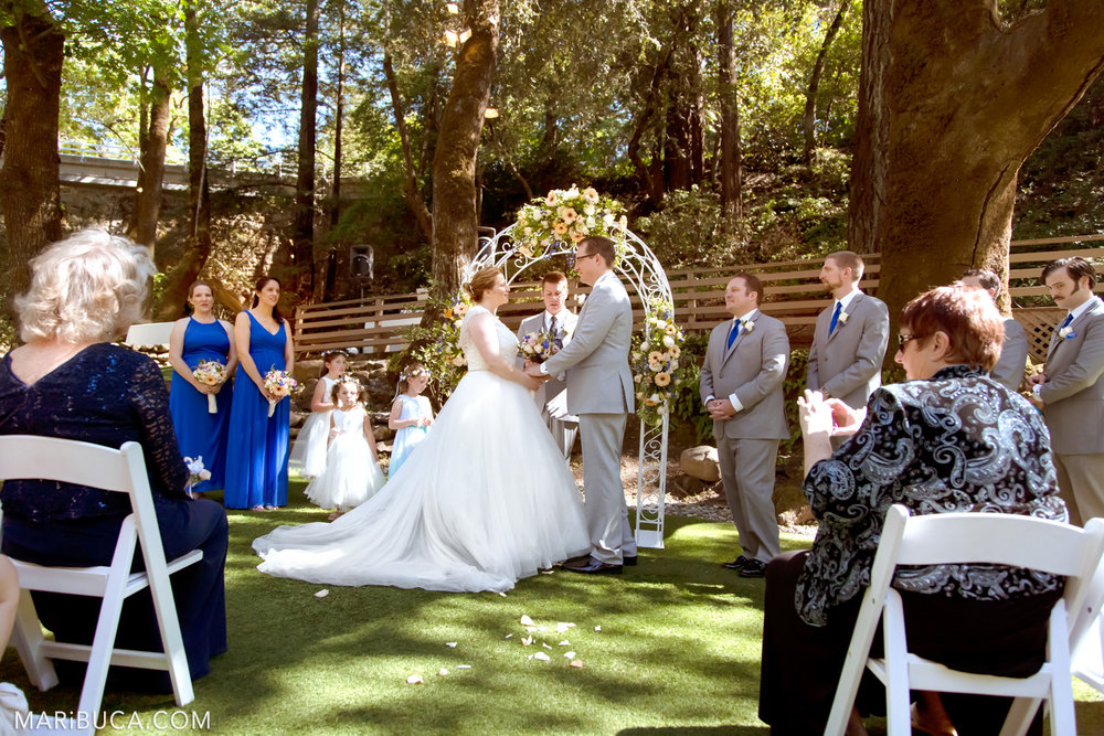 Wedding ceremony with bride, groom, guests and wedding party in the in the Saratoga Springs Wedding