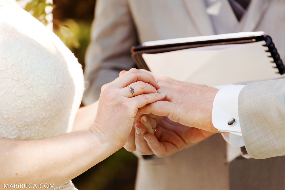 Bride and groom exchange wedding rings in the Saratoga Springs Wedding