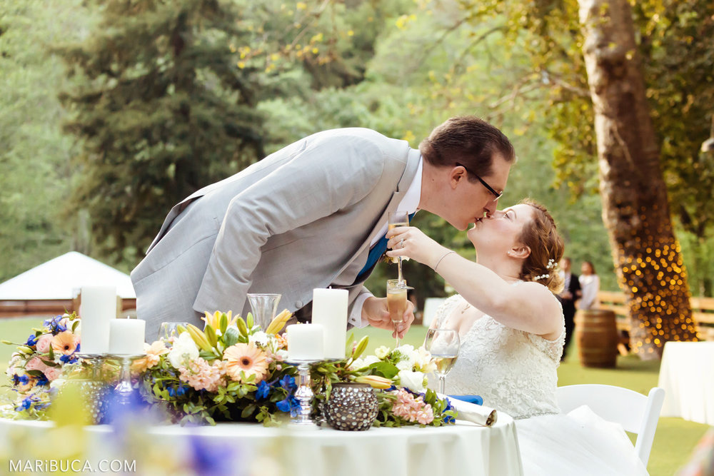 The bride and the groom kiss each other in the adorable venue in the Saratoga Springs Wedding