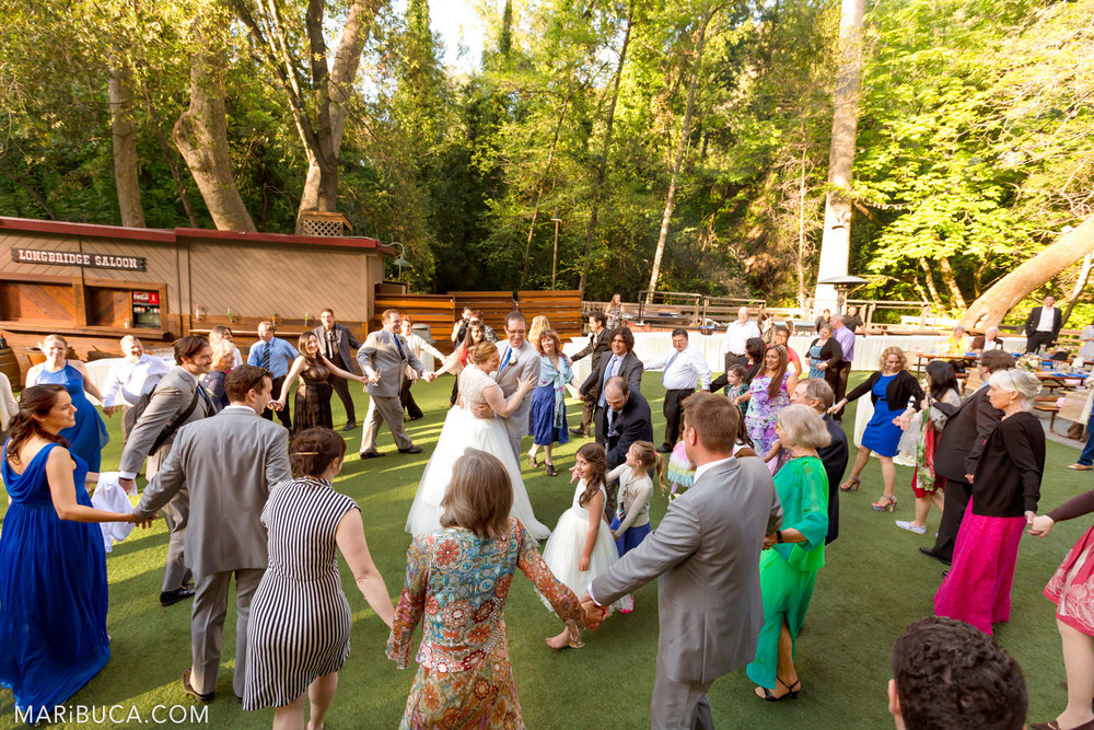 The bride and Groom stay in the center and the guest dancing around them in the Saratoga Springs Wedding