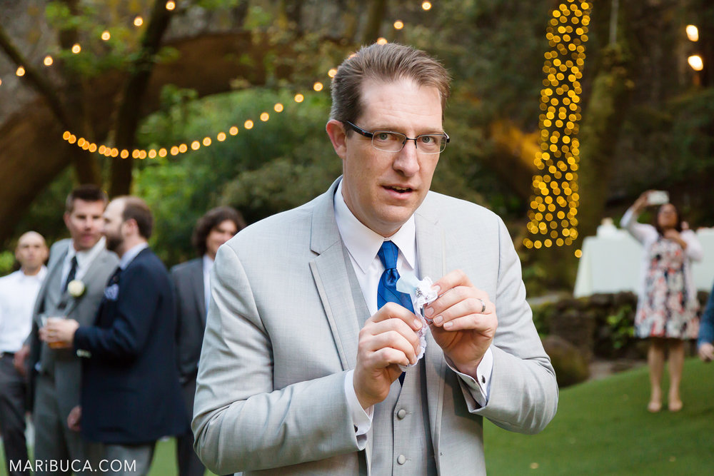 Portrait of the groom with white garter in the Saratoga Springs Wedding