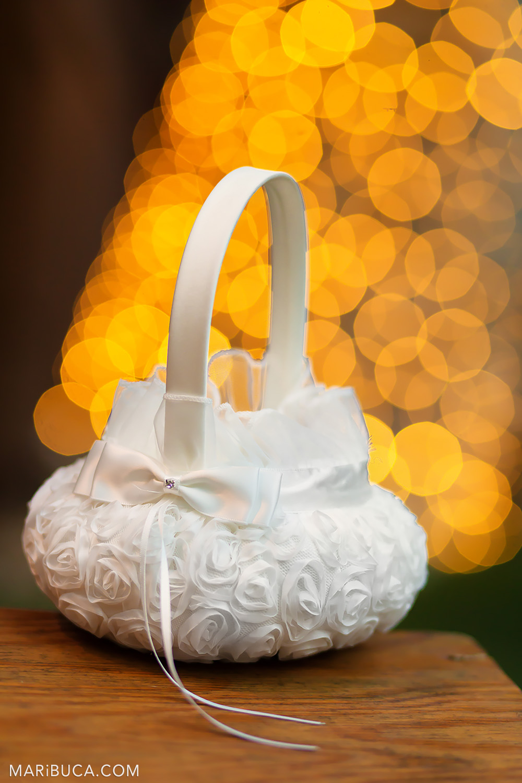 White wedding purse surrounded orange bokeh background lights in the Saratoga Springs Wedding