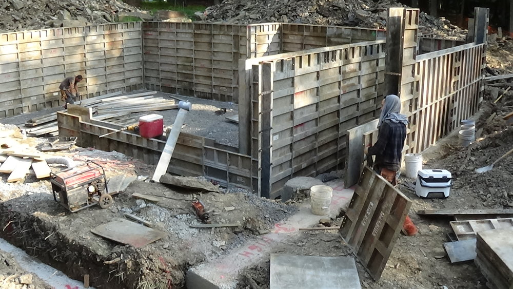 Forming basement walls  This is the time to make sure you look closely at exterior drainage installation and storm-water control at the foundation of our home.