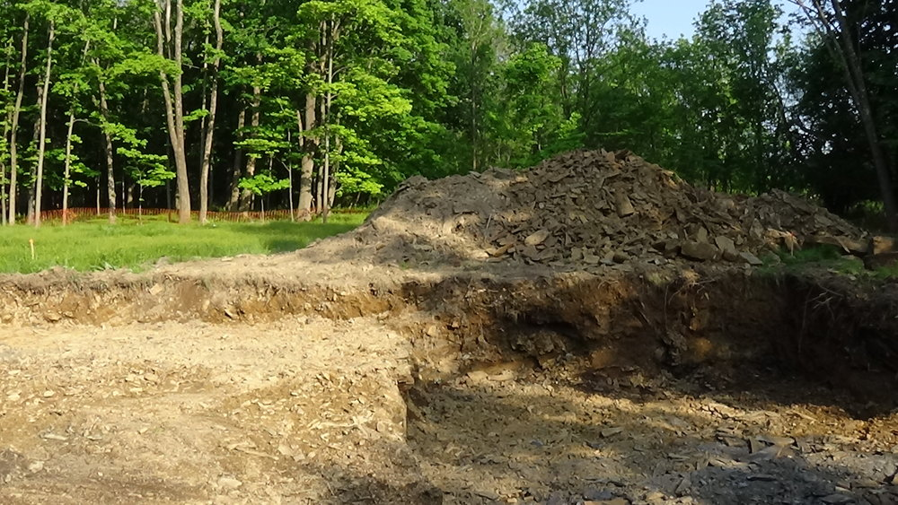 Foundation dig  A good time to see how groundwater may be running, and where we may have rocky soils.