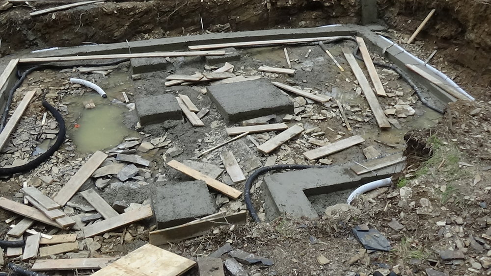 """Footing a pier installation  - This is an important time to look closely at solid """"thick"""" levels of concrete footing on solid ground."""