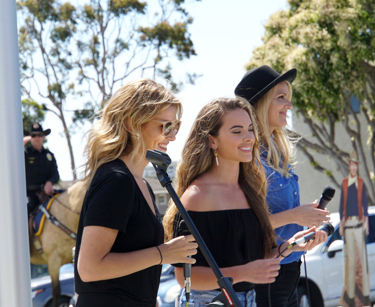 "Band ""Runaway June"" performing the National Anthem at the opening of John Wayne Park on May 26th, 2017. Photo courtesy of John Wayne Enterprises"