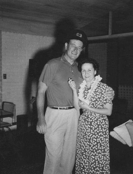 John Wayne and Mary St. John in Hawaii for Wayne's Wedding to Pilar Palette in 1954. Photo courtesy of John Wayne Enterprises