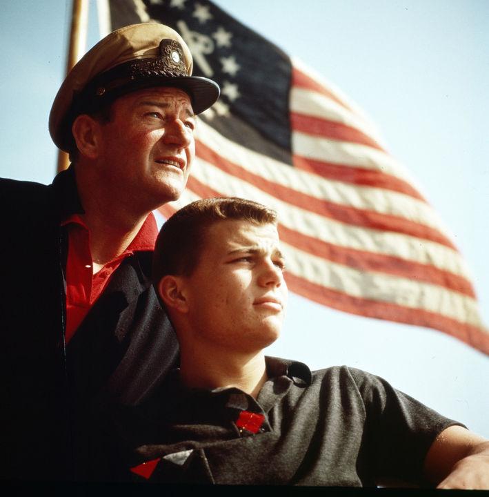 John Wayne and Patrick Wayne aboard Duke's boat the  Norwester  in the 1950s. Image by John R. Hamilton, photo courtesy of John Wayne Enterprises
