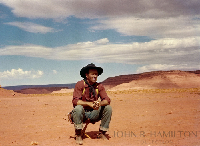 The final version after color correction- John Wayne between takes while filming  The Searchers  (1956). Image by John R. Hamilton, photo courtesy of John Wayne Enterprises. Print available for purchase at    johnhamiltoncollection.com
