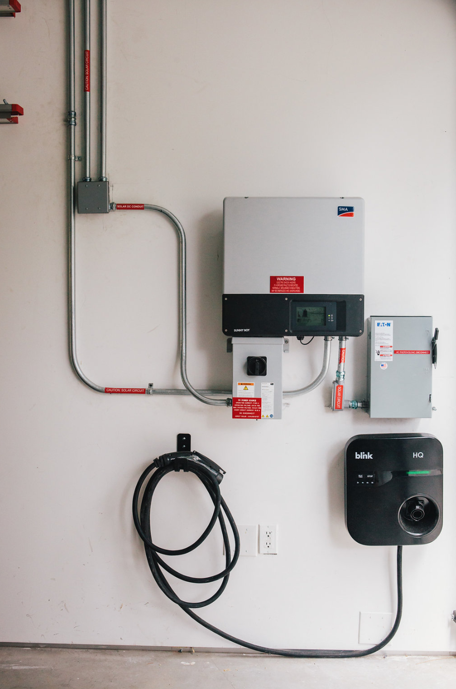 Roof mounted solar electric system consists of (24) 280 PV Panels and a SMA SB7000TL-US-22 Inverter and a 50-Gallon Solar Thermal System.